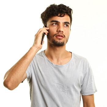 A young man talking on the phone