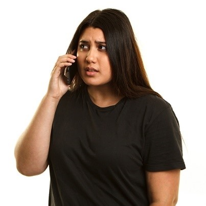 A young woman talking on the phone